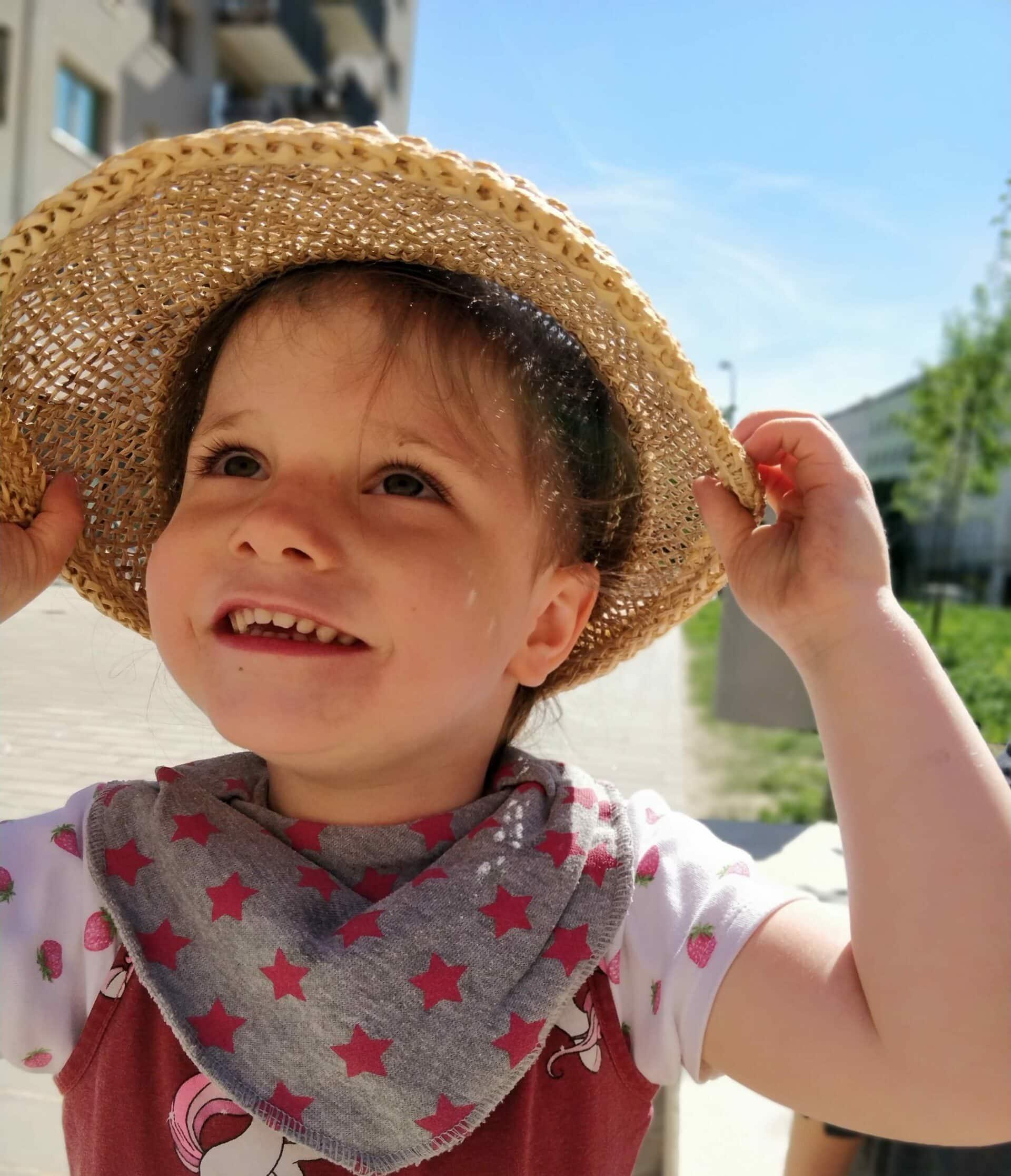 Little girl in hat.