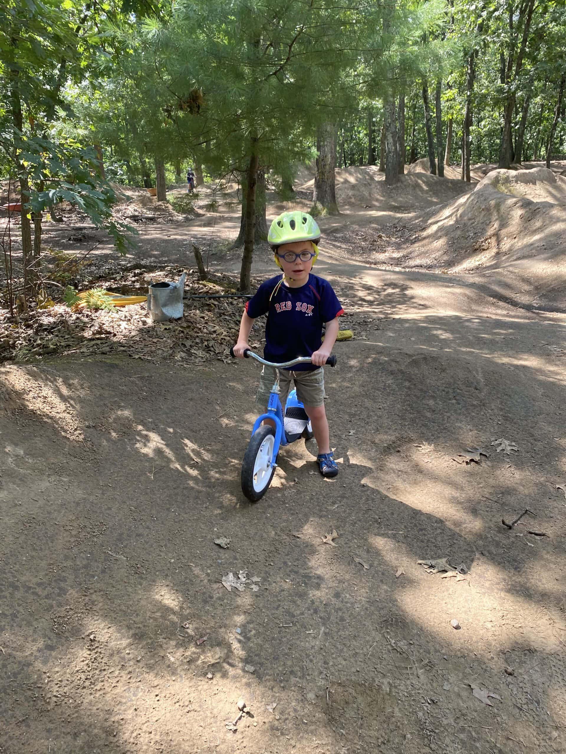Kid on a dirt trail riding his bike