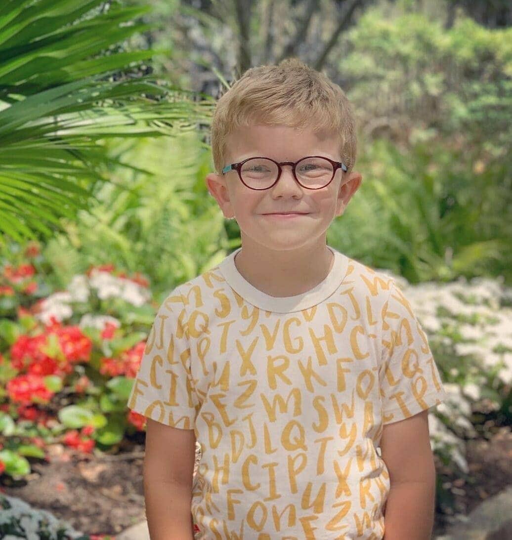 Smiling kid looking at camera