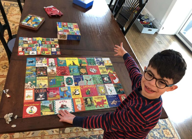 Happy child proud he did a puzzle